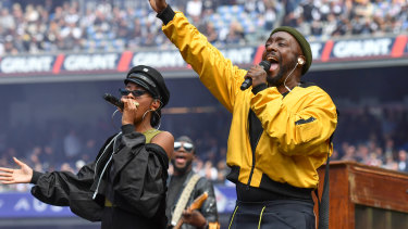 Will.i.am (right) and Jessica Reynoso before Saturday's AFL Grand Final.