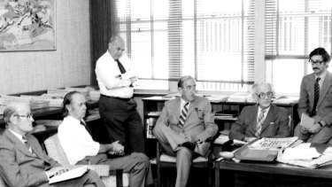 John O'Hara and other senior writers gathered in the office of Herald editor David Bowman in 1979 to discuss the day's editorial. Pictured (L to R) are Bob Bell, Lou Kepert, John O'Hara, Peter Hastings, H.G. Kippax, Spiro Zavos and David Bowman.