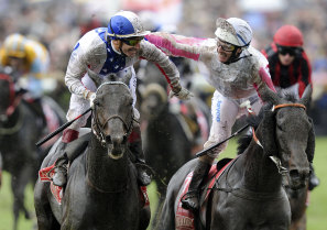 Gerald Mosse is congratulated by Luke Nolen after winning the Melbourne Cup on Americain in 2010.
