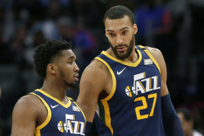 Utah Jazz teammates Donovan Mitchell (left) and Rudy Gobert have been afflicted by the coronavirus.