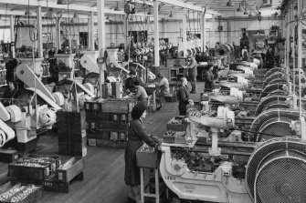 Workers on the factory floor: a small arms ammunition factory in Melbourne in 1969.