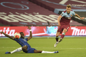 West Ham's Andriy Yarmolenko, right shoots and scores his side's third goal past Chelsea's Antonio Rudiger during the English Premier League soccer match between West Ham United and Chelsea at the London Stadium stadium in London.
