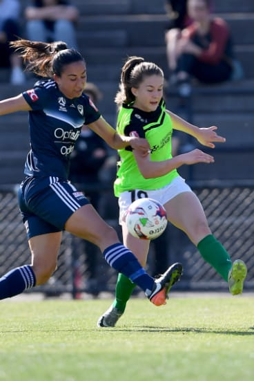Melbourne Victory's Gulcan Koca and Canberra's Aoife Colvill battle for the ball.