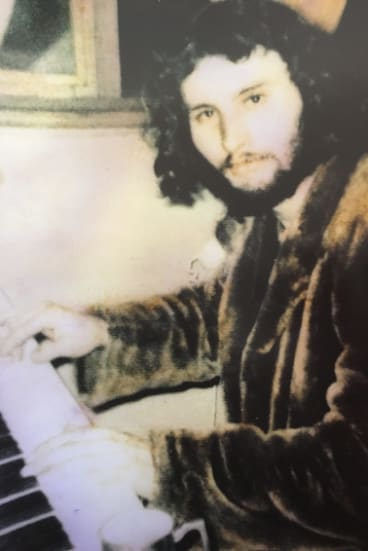 Tim, aged 21, at his piano.