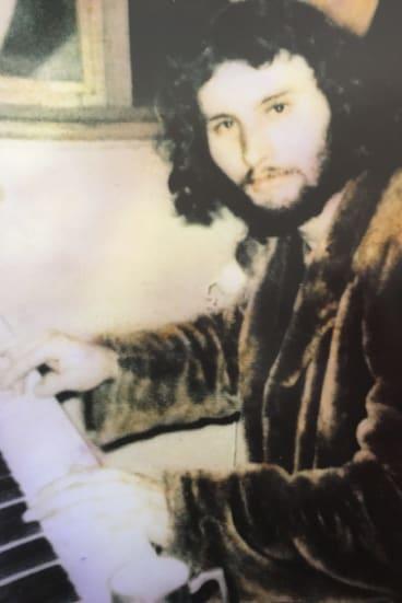 Tim, aged 21, at his piano.