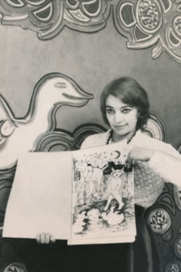 Mirka Mora hold up 'Mirka's Colouring Book No. One', 1970.