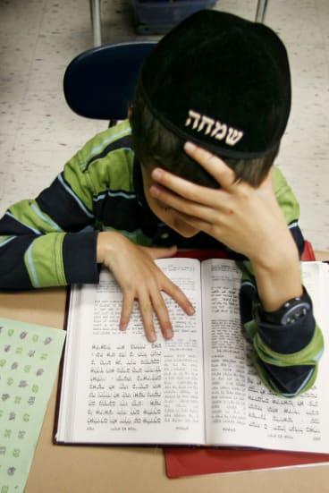 A boy studies Yiddish at a Hasidic school in Chicago in 2006.