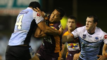 Past glory: Israel Folau in action for the Broncos against the Sharks in 2010.