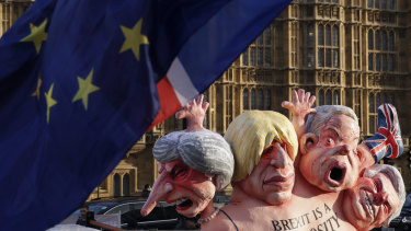 Flags fly above an anti-Brexit sculpture outside the Houses of Parliament in London.