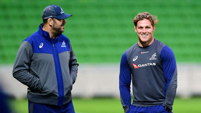 Upbeat: Wallabies coach Michael Cheika chats with Australian captain Michael Hooper at AAMI Park ahead of Saturday's Test against Ireland.