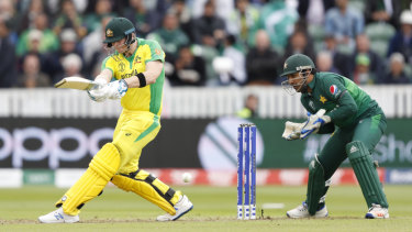 In swing: Australia's Steve Smith plays a shot off the bowling of Pakistan's Asif Ali.