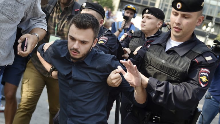 Police arrest a demonstrator during a rally protesting retirement age hikes in Moscow, Russia.