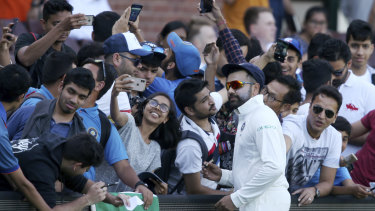 Star power: Rohit Sharma meets fans during a break in India's tour match in Sydney.