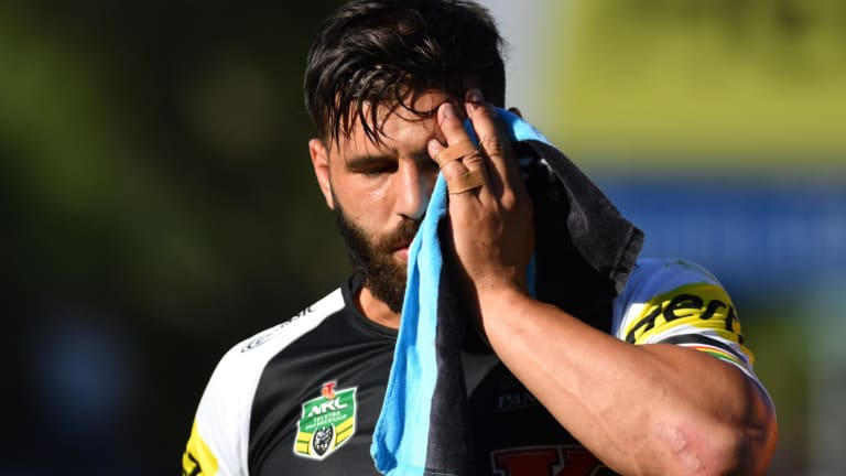Lucky: Josh Mansour leaves the field after sustaining a serious facial injury against Gold Coast Titans