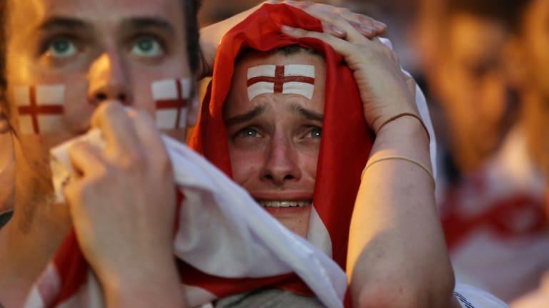 Devastated England fans after Croatia scored the winning goal.