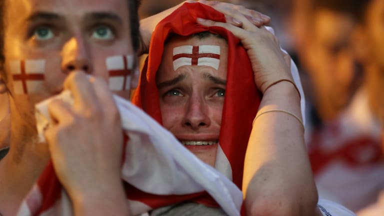 Devastated England fans after Croatia scored the winning goal.
