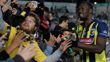 Star power: Reactions have ranged from harsh to kind after Usain Bolt's debut, but Mariners fans enjoyed the spectacle.