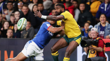 Marika Koroibete gets an offload away before going into touch.