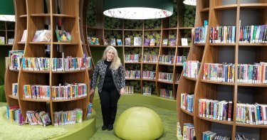 Specialist library designer Cecilia Kugler surrounded by her work at Bayside Library Rockdale.