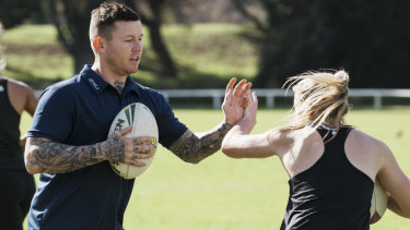 Mentor: Todd Carney conducts sprint training clinics with Roger Fabri at Centennial Park.
