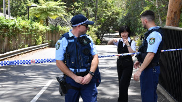 NSW Police at the scene of a double stabbing at the Church of Scientology headquarters at Chatswood.