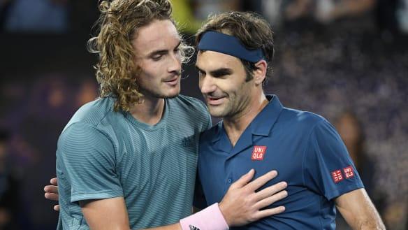 Greece's Stefanos Tsitsipas, left, is congratulated by Switzerland's Roger Federer