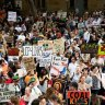 Climate change protesters rally against Scott Morrison's response to the bushfire crisis in Sydney on Friday.