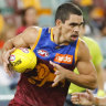 Lions outlast Swans at drenched Gabba
