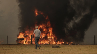 Orangeville residents defend their property as bushfire approaches on Friday.
