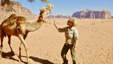 Michele Cotton with a camel in Jordan.