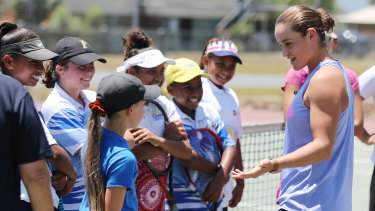 Wednesday: Talking tennis during a clinic in Cairns with youngsters.