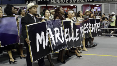 Dancers from the Vai-Vai samba school pay homage to the slain councilwoman Marielle Franco during Carnival.
