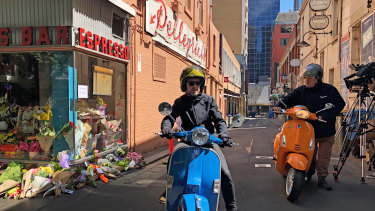 Members of the Vespa Club of Melbourne outside Pellegrini's on Sunday.