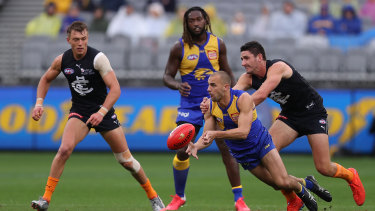 Point of difference: Eagles' Dom Sheed prepares to take a grab.