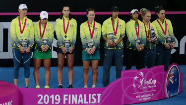 Commiserations: Team Australia accept their trophies after losing the decider against France.