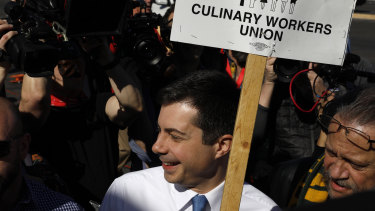 Pete Buttigieg walks in a picket line with Culinary Workers Union members outside the Palms Casino Resort in Las Vegas. So many Democratic presidential candidates showed up at thepicket line that it could have doubled as a presidential forum.