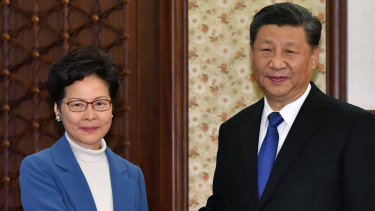 Hong Kong's leader Carrie Lam with Xi Jinping. Lam will have the power to pick judges in national security cases.