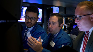 Traders on the New York Stock Exchange. US stocks rose amid hopes the US and China may be getting close to reaching a trade deal.