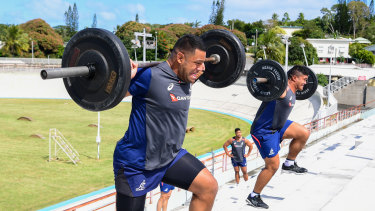 Scott Sio and Jordan Uelese get stuck into some tough training.