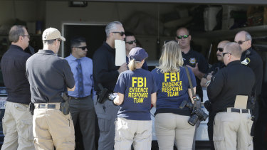Authorities huddle outside a home searched in connection with the case in Citrus Heights, California.