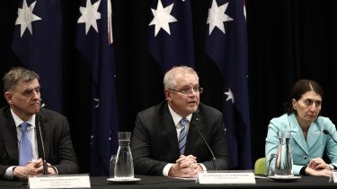 The footy opener plays on ... Prime Minister Scott Morrison, flanked by Chief Medical Officer Brendan Murphy and NSW Premier Gladys Berejiklian on Friday afternoon.