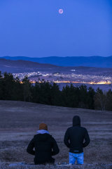 Spectators watch the lunar eclipse from the National Arboretum.