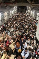 Afghan citizens are evacuated by the US Air Force from Hamid Karzai International Airport in Kabul.