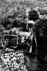 August Schreitmueller's sandstone sculpture The Goodness overlooks the destroyed city of Dresden from the Town Hall Tower in 1945.