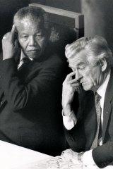 Nelson Mandela with Prime Minister Bob Hawke at a press conference in Canberra during Mandela's Australian visit.
