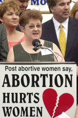 McCorvey addresses a large group of anti-abortion supporters in Dallas in 2003.