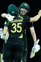 Tahlia McGrath and Georgia Wareham celebrate victory.