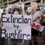 Thousands gather in Sydney's CBD to demand action on climate change after the Black Summer fires.