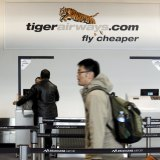 Passengers arrive to check in at the Tiger Airways terminal at Melbourne Airport.
