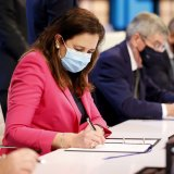 Queensland premier Annastacia Palaszczuk and IOC president Thomas Bach sign the agreement after Brisbane was announced as the 2032 Olympics host city.